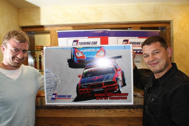 Daniel Akhromstev (right) accepts his award for the GT title with the Red Star Racing team crew chief.