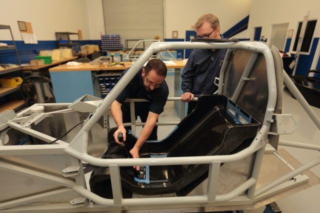 Élan inventory and logistics manager Darren Hurst (left) discusses harness mounting with senior engineer Robert Lindsey.