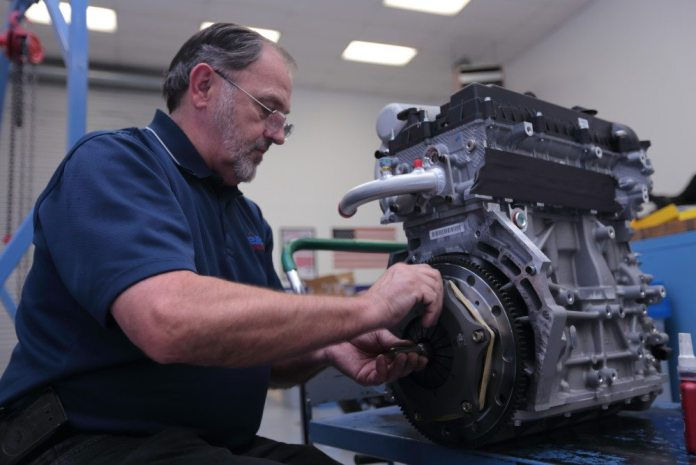 Élan car builder Mickey Watkins installs the ACT Clutch on the Mazda MZR engine before installing the transaxle.