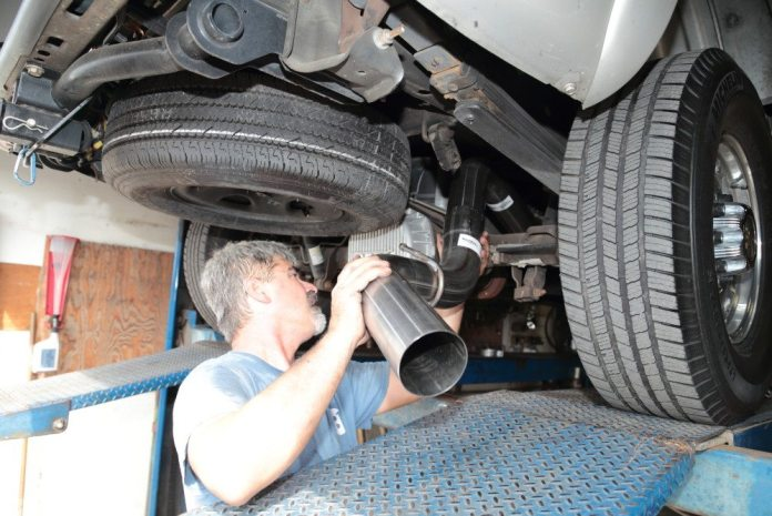 With the front of the system hung and the muffler in place, Martin hangs the tailpipe. He leaves all fasteners loose until all the pieces fit together the way he wants them.