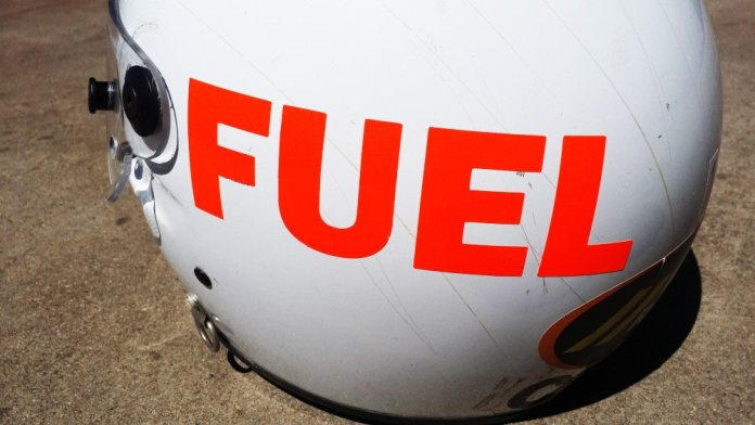 """NASA allows crew members to use expired helmets. However the requirement is that the helmet be clearly marked with the word """"FUEL"""" as to distinguish an expired helmet from a current one. If a NASA official ever sees an HPDE driver heading out onto the track with a big orange """"FUEL"""" on the side of his helmet, I can guarantee you that driver will be on a very short session. Each of our crew helmets uses a clear face shield and has a GoPro mount for pit-stop-filming opportunities."""