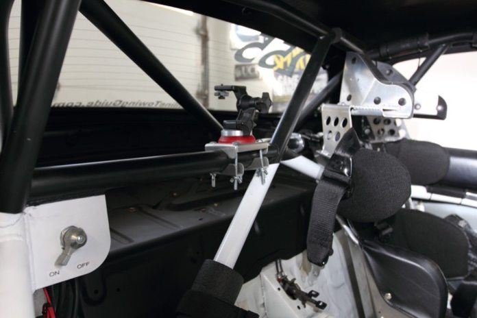 "Painting the upper spans of the roll cage and the rear package tray flat black greatly reduces glare in the mirror, and helps the cage ""disappear"" when you're driving."