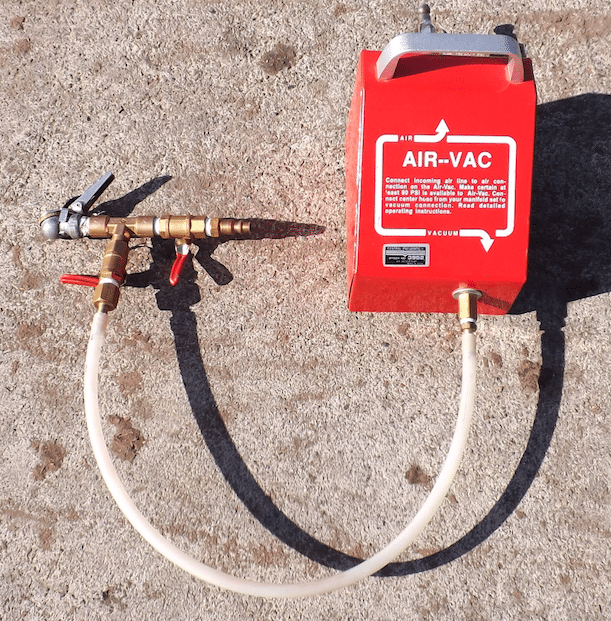 The $19 Air Vac box from Harbor Freight uses air pressure on one side of the box to create a venturi effect, which sucks the air out of the other side of the box. With a small hose, a few brass fittings, valves and a chuck to fit into the valve stem of a tire, we have created our own homebuilt tire-evacuation system.