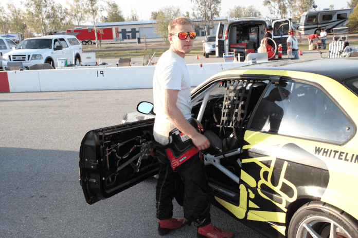 Valentin Ivanitski helps his wife Savannah get strapped in for their first endurance race as a married couple at Buttonwillow Raceway Park in April 2013.