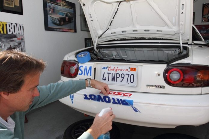 Spray the adhesive side of the decal with Windex after or as you peel away the backing paper.