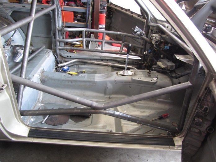 Strong bent the main hoop and down bars at a friend's shop, and built the rest of the cage in his garage at home.