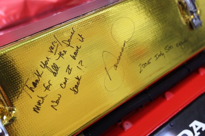 Danica Patrick signed her engine from the 2005 Indy 500, which was converted to a show piece.