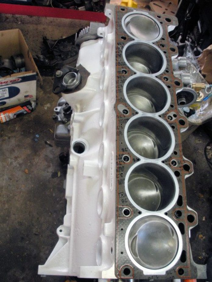 Be sure to install the head gasket right side up. It will fit on upside down, but it will block oil and coolant passages.