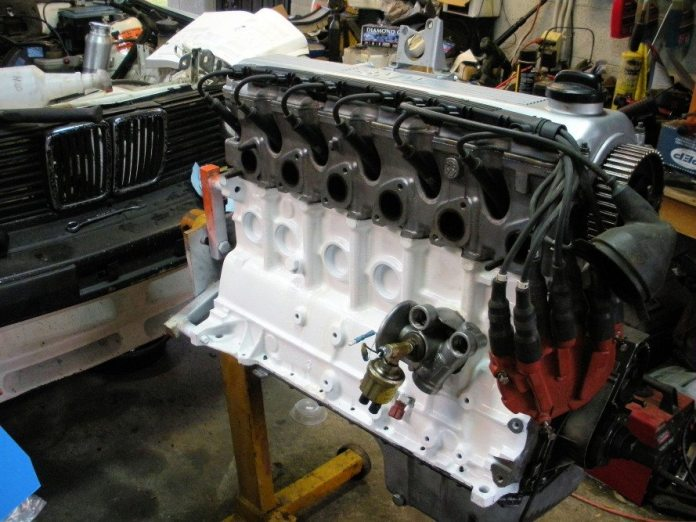 With the long block assembled, you can begin to install the peripheral equipment. It's a good idea to replace the water pump and timing belt tensioner.