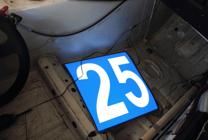 With the number panel lying inside the car, you get a better idea of how brilliant they are. At night, these are visible from hundreds of feet away. Now tidy up the wiring and you're done.