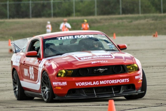 The clear rear spoiler on Amy and Terry Fair's Mustang is effective at all speeds, and it provides full rear visibility. A spoiler this tall is only optimum for autocross because the drag it creates at higher speeds would produce slower lap times on a road course.
