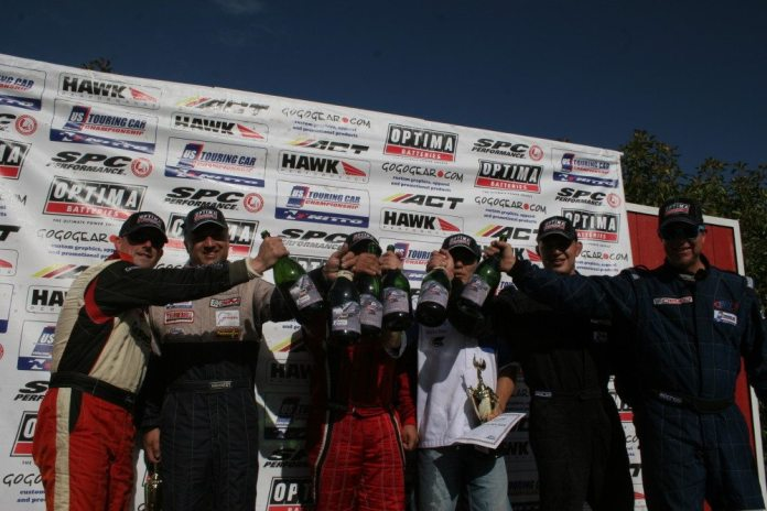 Podium finishers are all smiles and champagne at the USTCC event at Thunderhill Raceway.