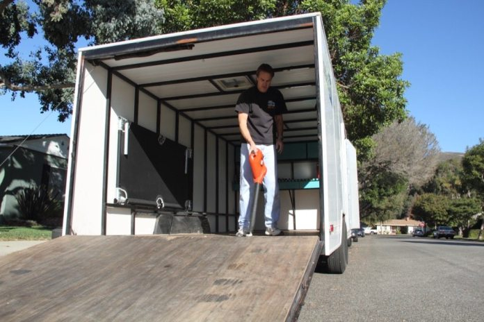 After you sweep out the trailer, use a leaf blower to get out the smallest bits of dirt and debris so the matting will lay flat, with no bumps under it.