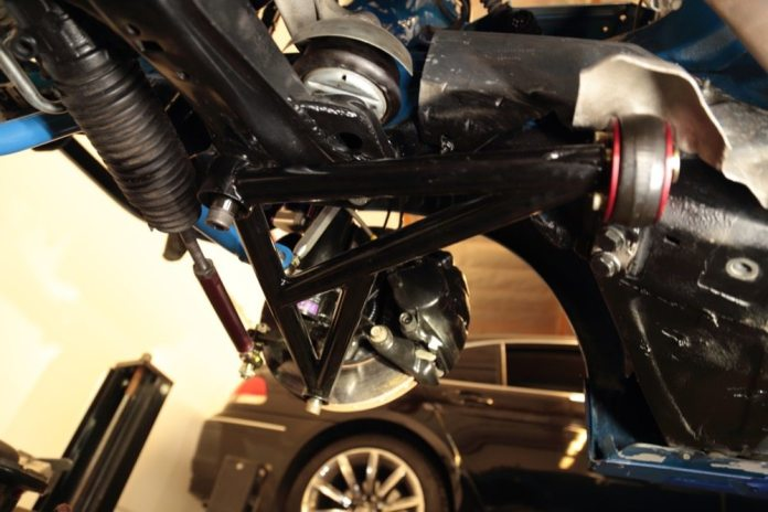 Up front, ITDG installed Bimmerworld lower control arms and bushings and reinforced the subframe where it attaches to the unibody, which also is where the engine attaches. ITDG also welded braces on the underside of the strut towers.