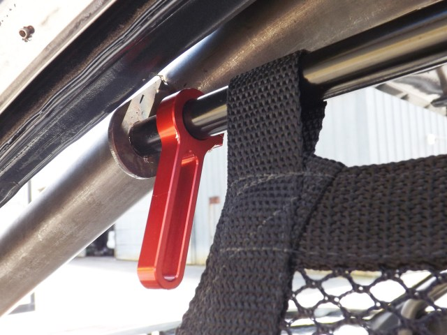 "Here you can see up close the handle that comes with the Joes Racing Products kit. This is easy to ""handle"" when you want to raise or lower the net. A pull back on the handle disengages the window net to freely fall downward."