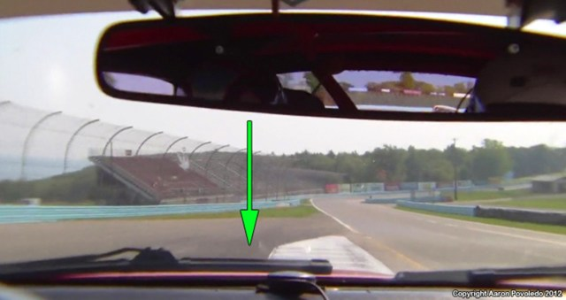 Turn 1 Exit: Try going beyond the curb to create a bigger arc and more overall speed.