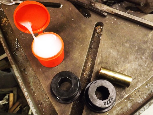 Now it is time to replace your soft rubber bushing with a polyurethane piece. Use the provided grease to coat the bushings. You want the bushings to rotate inside the lower control arm and not bind. The bushing material provides the tightness in the suspension. The grease helps things move as they should, fluidly, without binding.