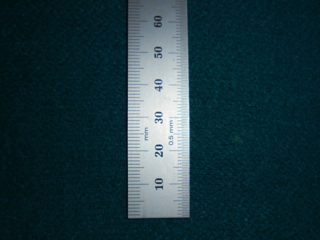 The first small metal ruler we used to measure toe was problematic because it had inches on one side and millimeters on the other. We found this millimeter-only ruler, where both sides of the ruler measure in millimeters, was much easier to use.
