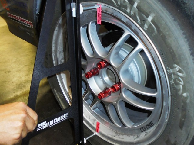 The Smart Camber tool has a hands-free three-post option, but we found the two-post option was quicker and easier to use, especially after we took the time to place small adhesive tabs to mark the wheel for repeatable measurements.