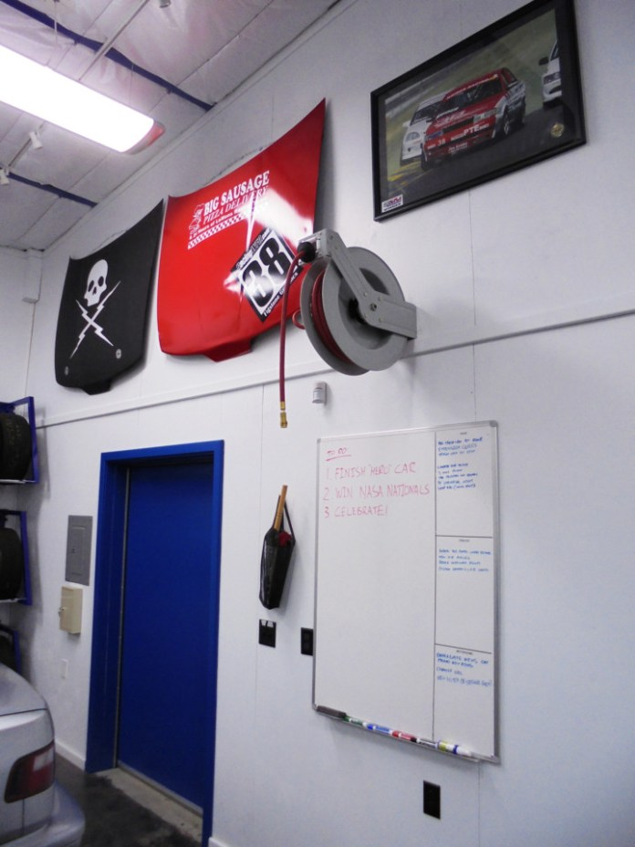 We love dry-erase boards. They are an easy way to track all the stuff we need to remember to do. We also love keeping air lines off the floor and out of the way. We placed the air compressor outside to keep the noise down and plumbed air reels all around the lift for easy access.