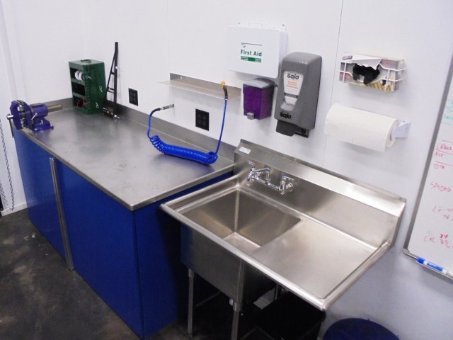 Having a place to wash your hands is crucial in a race shop. We also have a rubber-glove dispenser to keep hands clean for really dirty jobs, and a first aid kit.