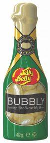 """Die neue Geschmacksrichtung """"Sekt"""" kommt ohne Alkohol aus und schmeckt fruchtig, weniger süß. Mit der hellgoldenen Farbe und der glänzenden Optik ist die Bohne einem sprudelnden Glas Sekt nachempfunden und sind sehr hübsch verpackt in goldverzierten Miniatur-Sektflaschen zu 42 Gramm."""