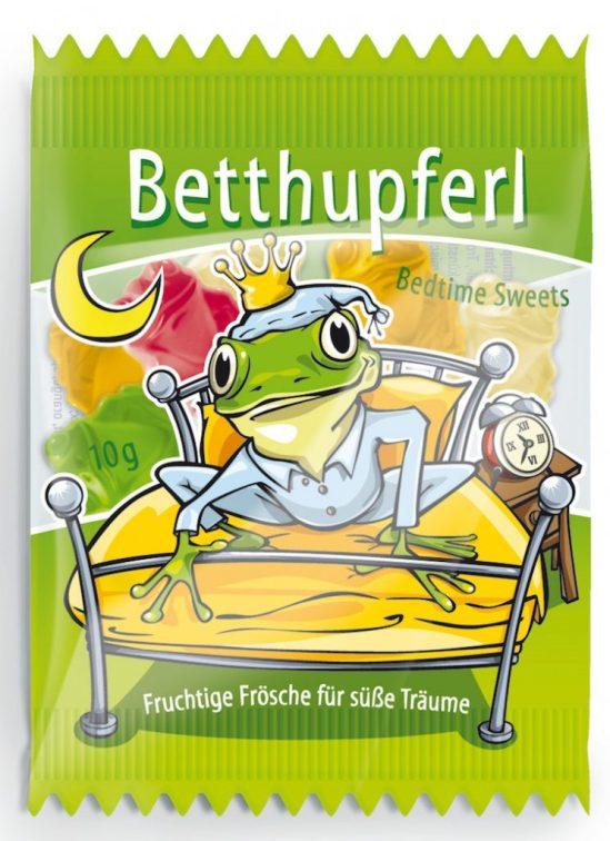 Hellma Betthupferl mit einem niedlichen Frosch im Schlafanzug.