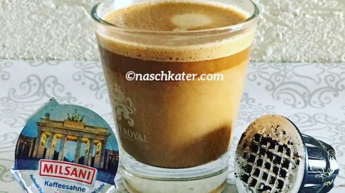 Kaffeekapsel und Milchdöschen