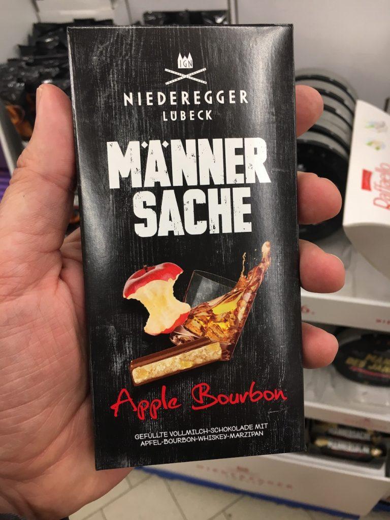 Niederegger Lübeck Männersache Apple Bourbon Gefüllte Vollmilchschokolade mit Marzipan