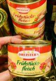 Dreistern Frühstcksfleisch in der Dose mit rotem und grünem Paprika