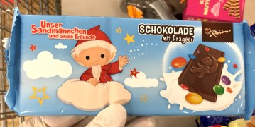 Rotstern Schokolade mit Dragees-Schokolinsen Unser Sandmännchen und seine Freunde