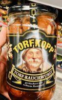 Torfkopp Torf-Rauchwurst Würstchen Motiv Mensch