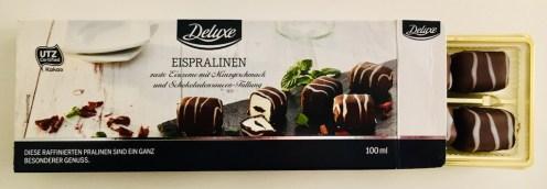 Lidl Deluxe Eispralinen mit Minzgeschmack und Schokoladensaucen-Füllung geöffnet 100G