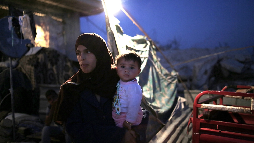 Many families in Gaza have been living in the ruins of their homes  [EPA]
