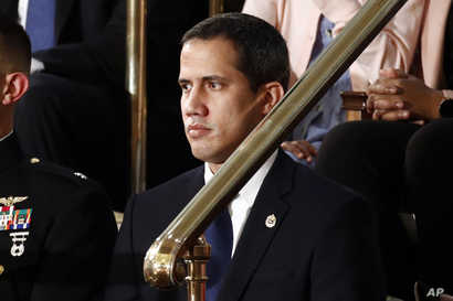 Venezuelan opposition leader Juan Guaido listens as President Donald Trump delivers his State of the Union address to a joint…