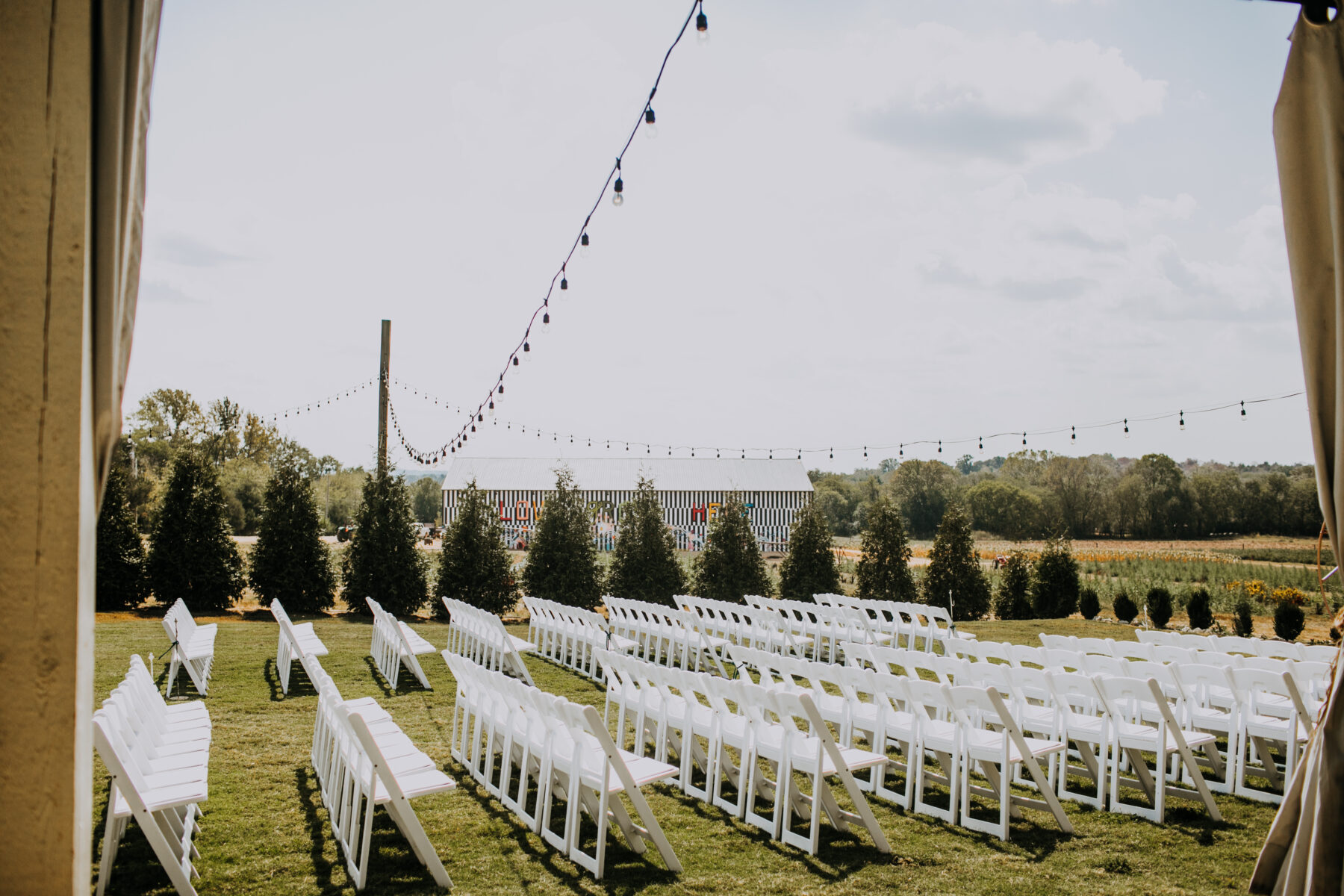Outdoor wedding ceremony: Nashville Wedding with Beautiful Views by Teale Photography featured on Nashville Bride Guide