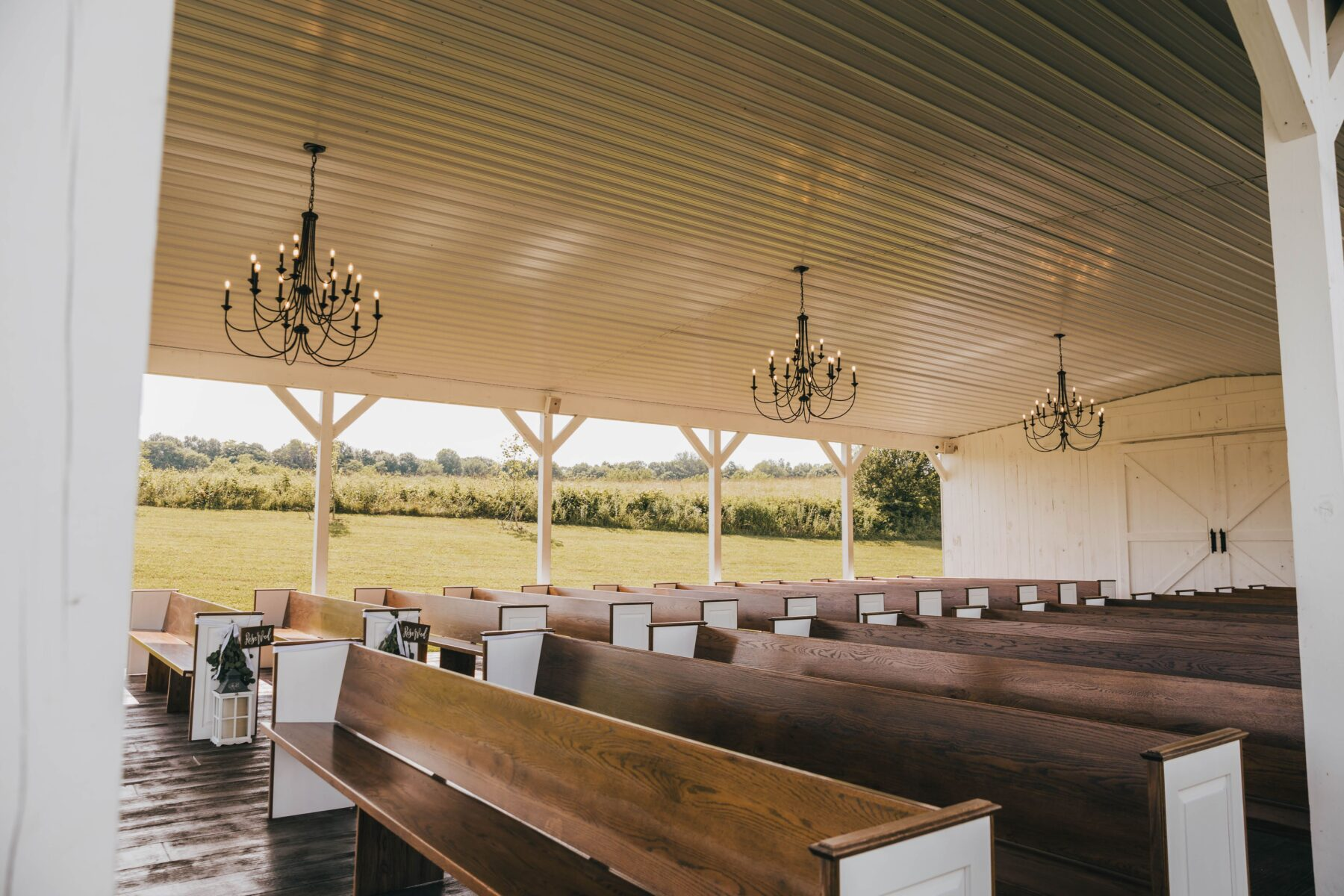 Semi-outdoor wedding ceremony decor: White Dove Barn Wedding by Grace Upon Grace Photography featured on Nashville Bride Guide