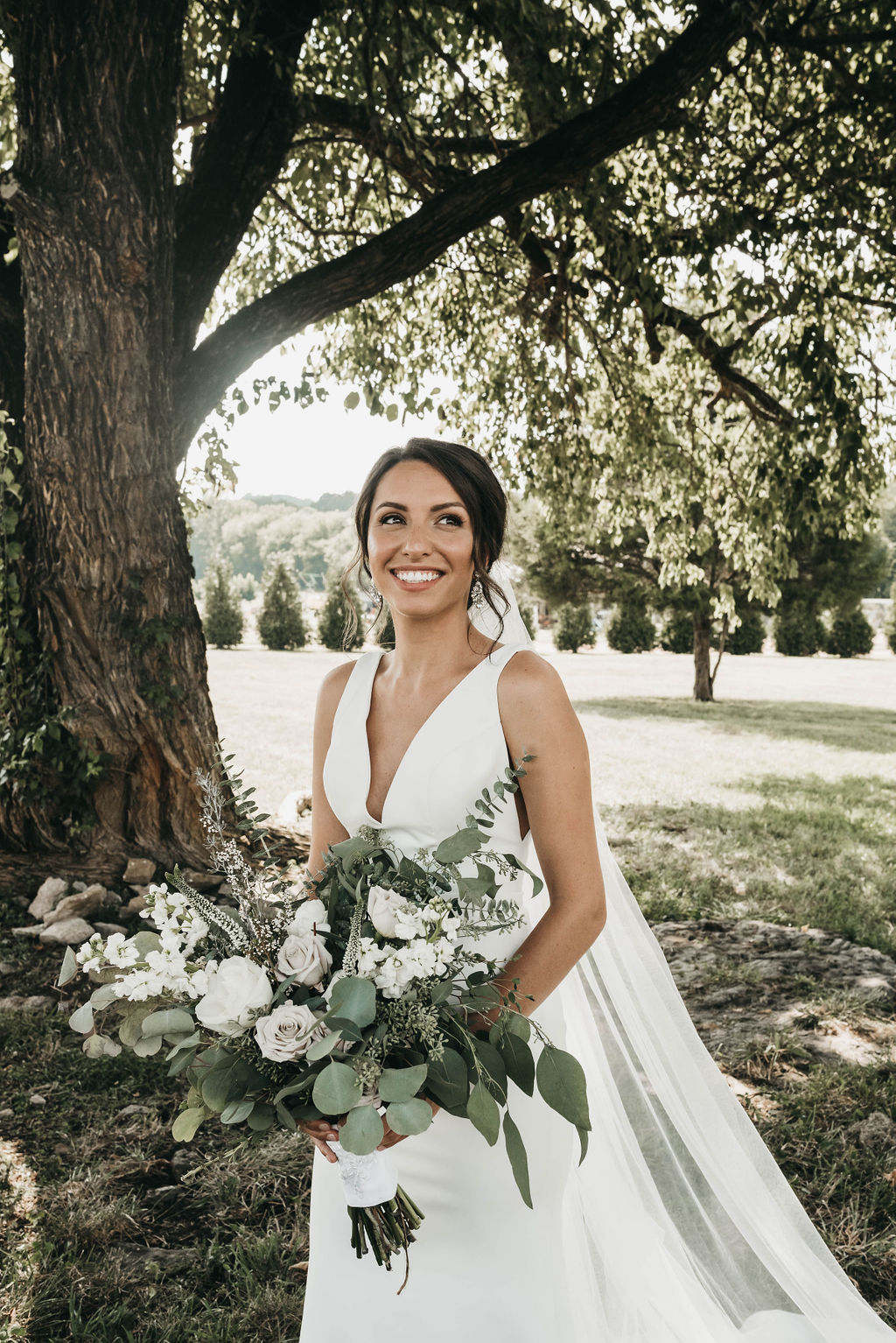 Bridal portrait with white and greenery wedding bouquet