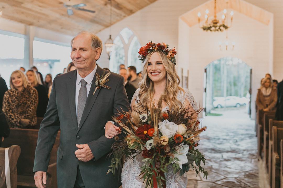 Father escorting bride down the aisle