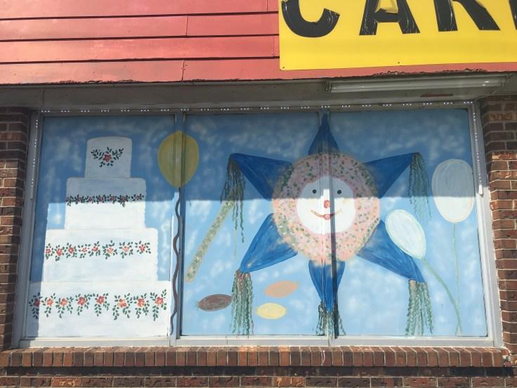 Piñata and cake mural street art Nashville