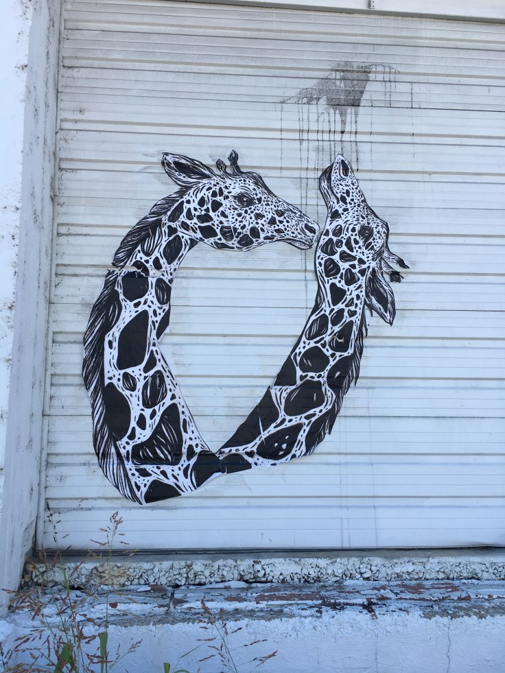 Giraffes sticker street art Nashville