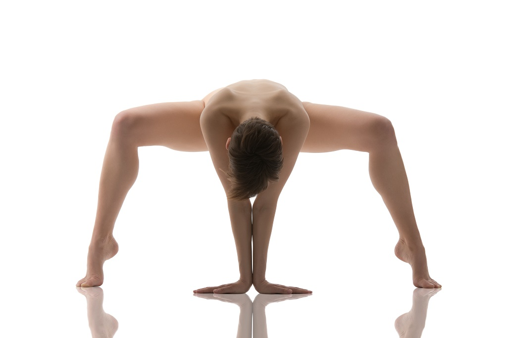 eautiful young woman practicing yoga