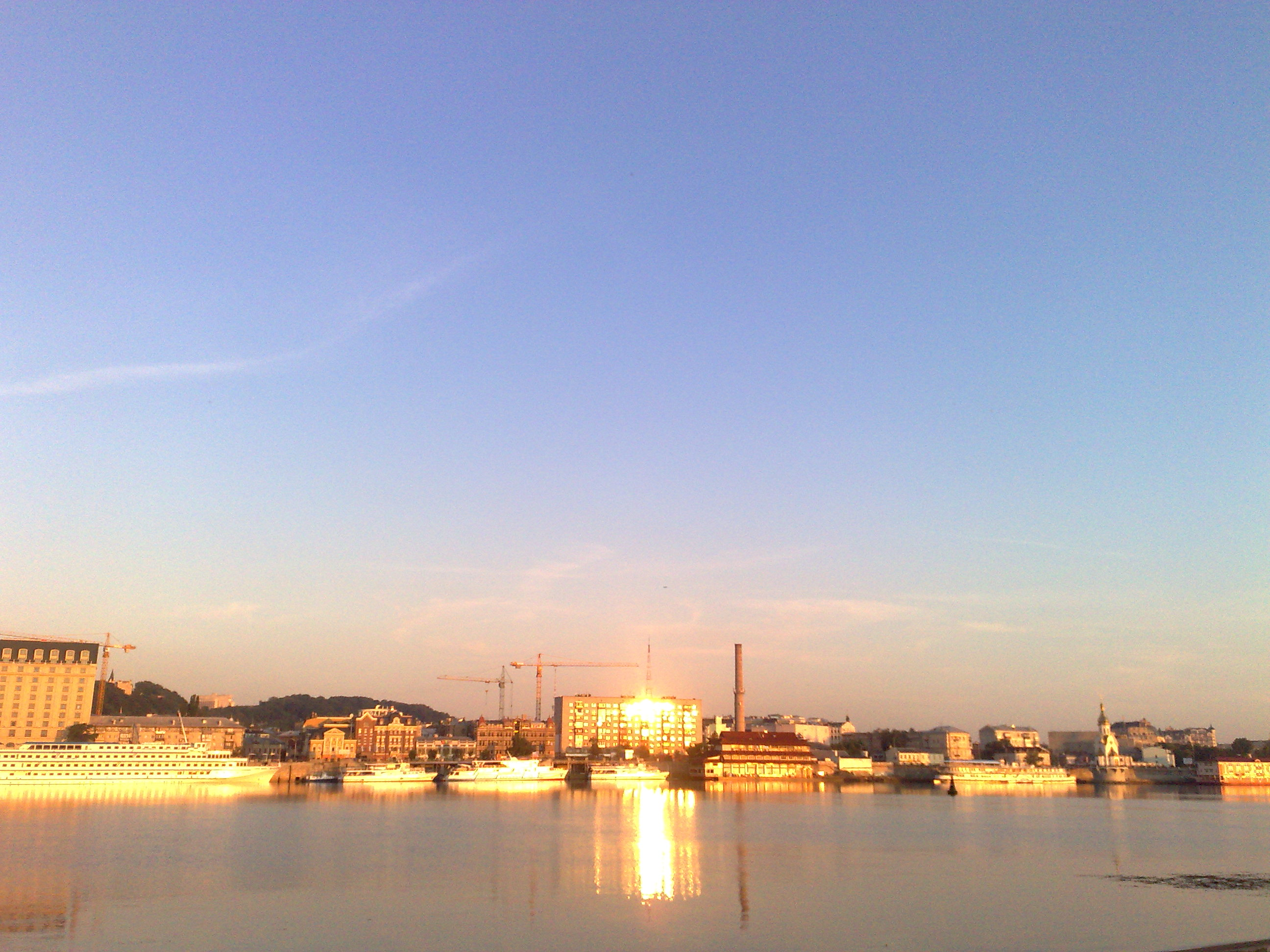 dawn breaks over the Dnipro, and reflects in the windows