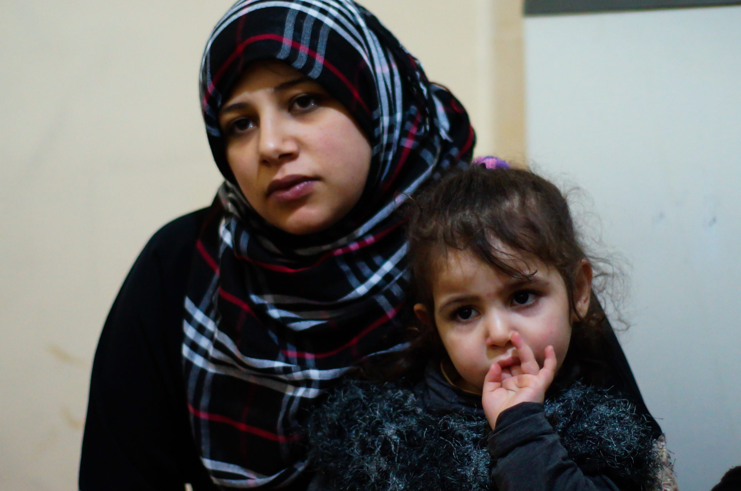 : Douaa (24) with her daughter who is suffering from asthma as a result of long and exhaustive escape through the Qalamoun Mountains into Lebanon.