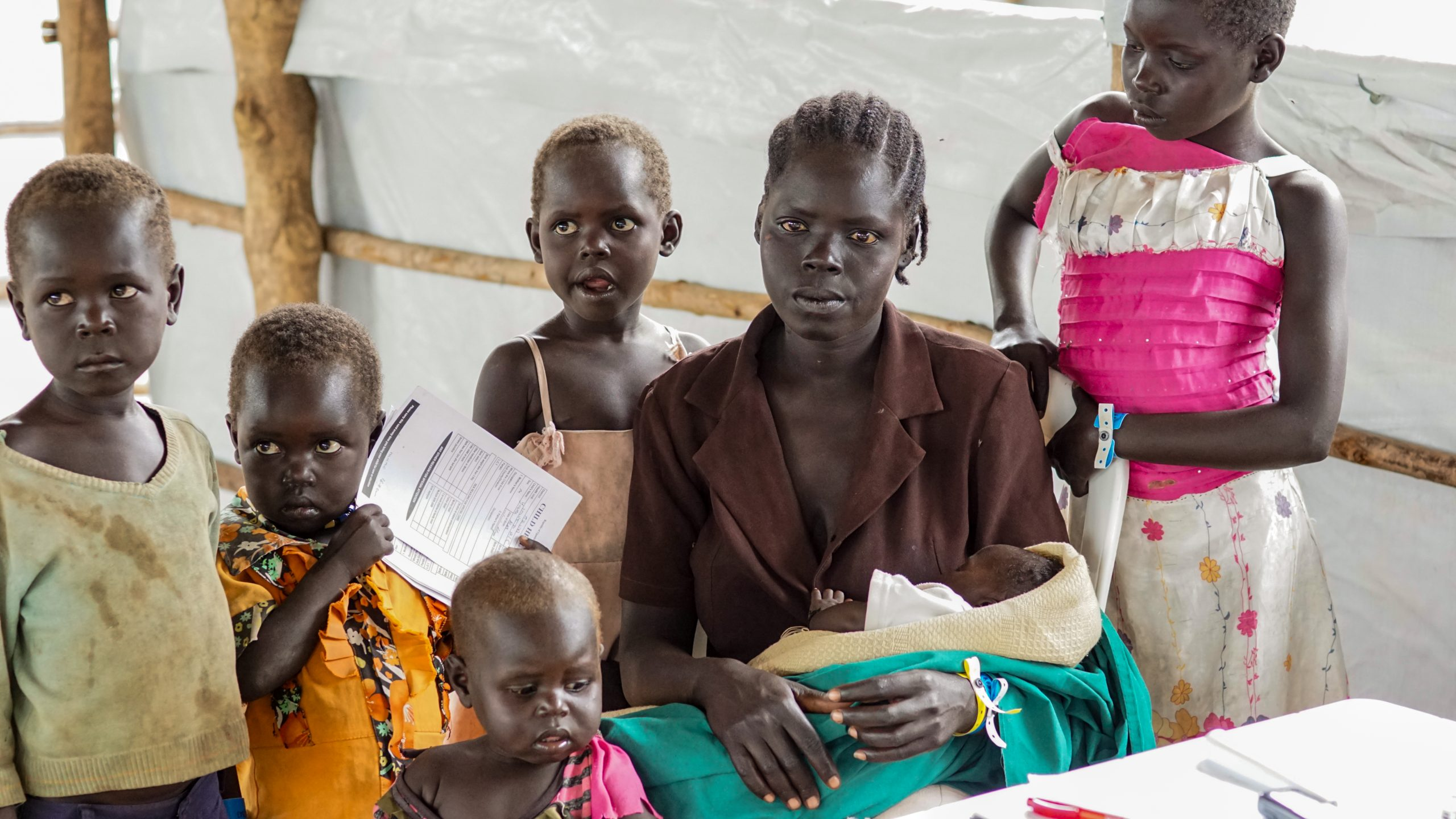 Joan Jane is 28-year-old mother to six children. Her home town was attacked by rebels who killed her neighbours and stole the cattle. As she safety made to Imvepi Refugee Camp in Uganda, her husband was still trying to leave Juba, South Sudan.