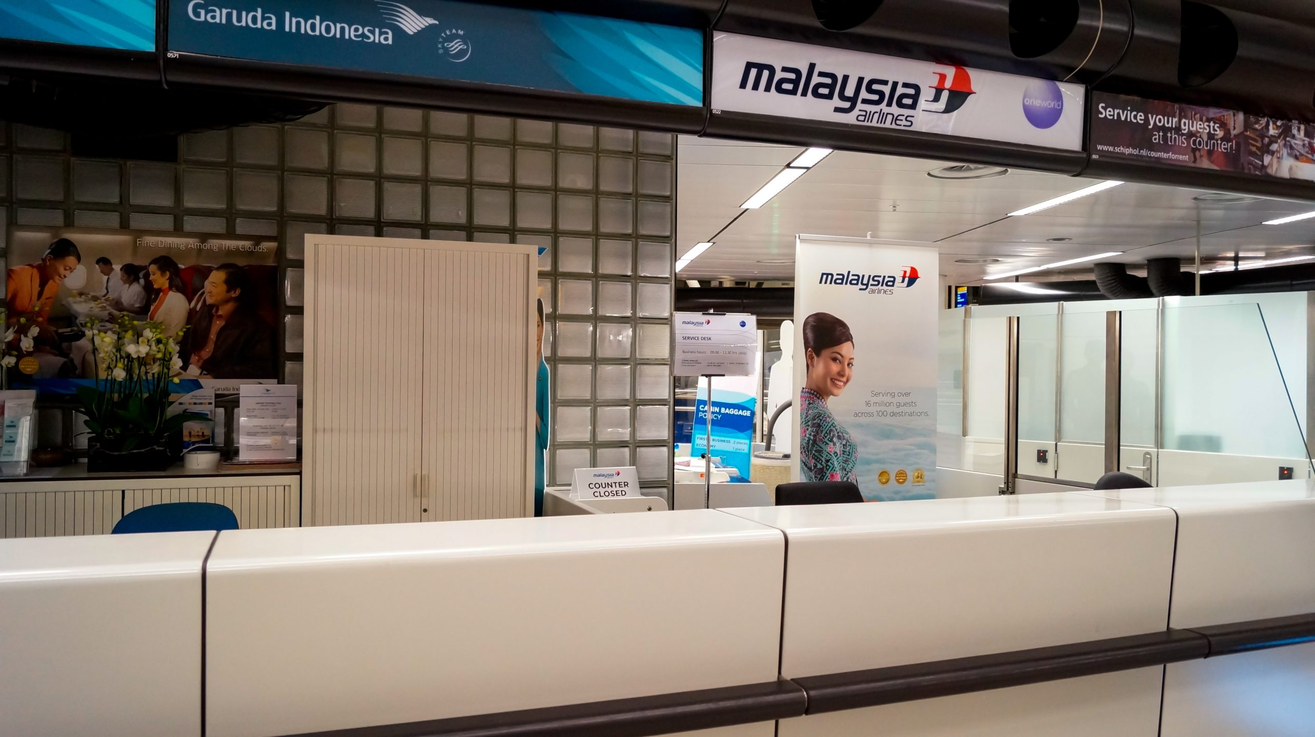 July 18, 2014: Schiphol Airport in Amsterdam, Departures Terminal 3, night hours. Closed counter of the Malaysia Airlines only a few hours after the information that the airline's plane flying from Amsterdam to Kuala Lumpur was shot down over the Ukraine.