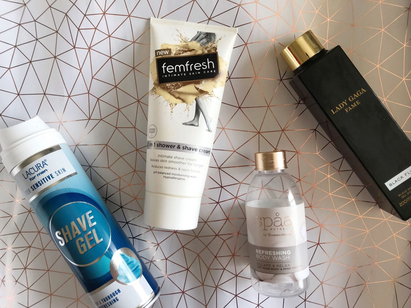 product empties (shower and body) flat-lay