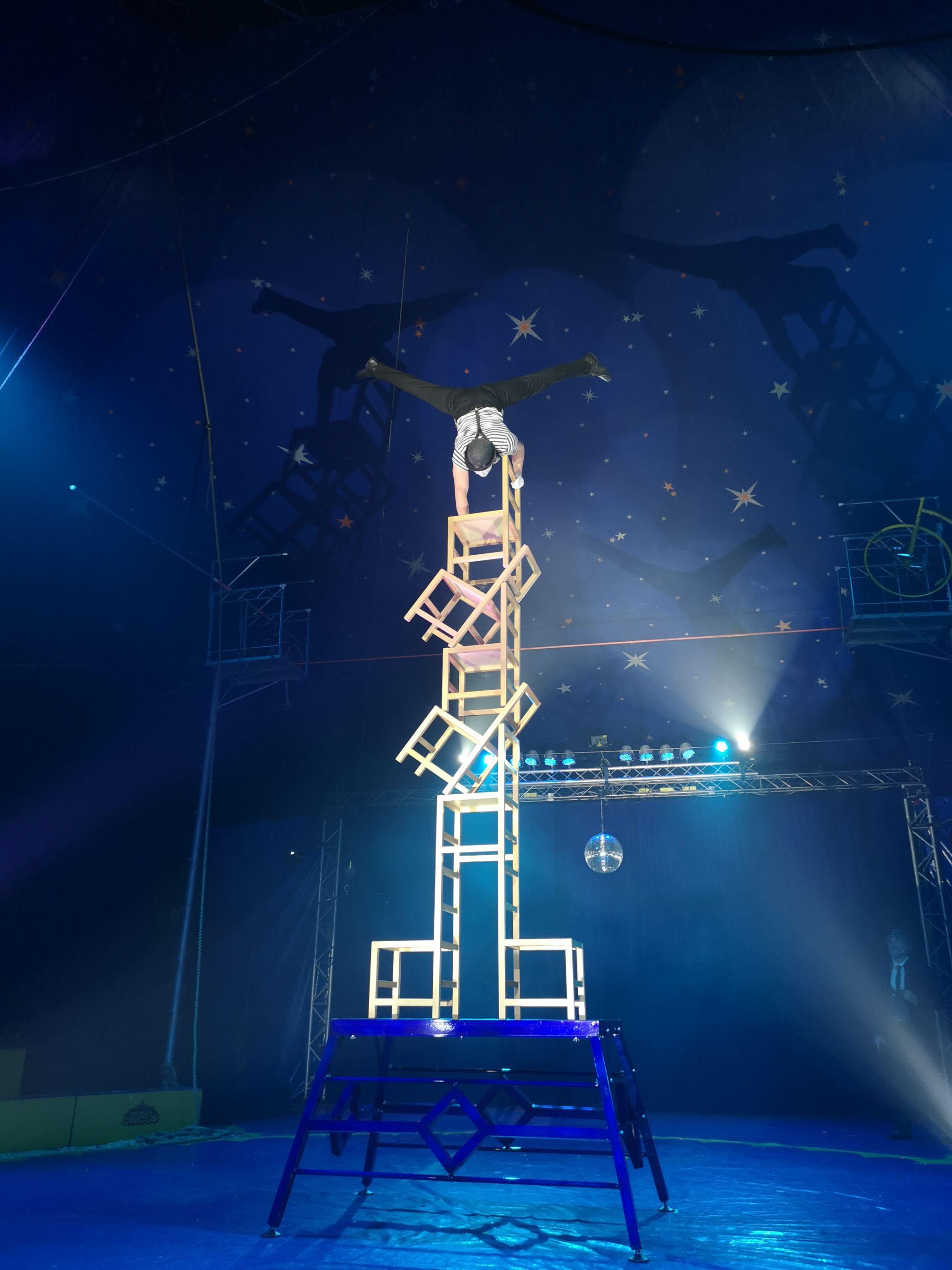 circus Act balancing on chairs