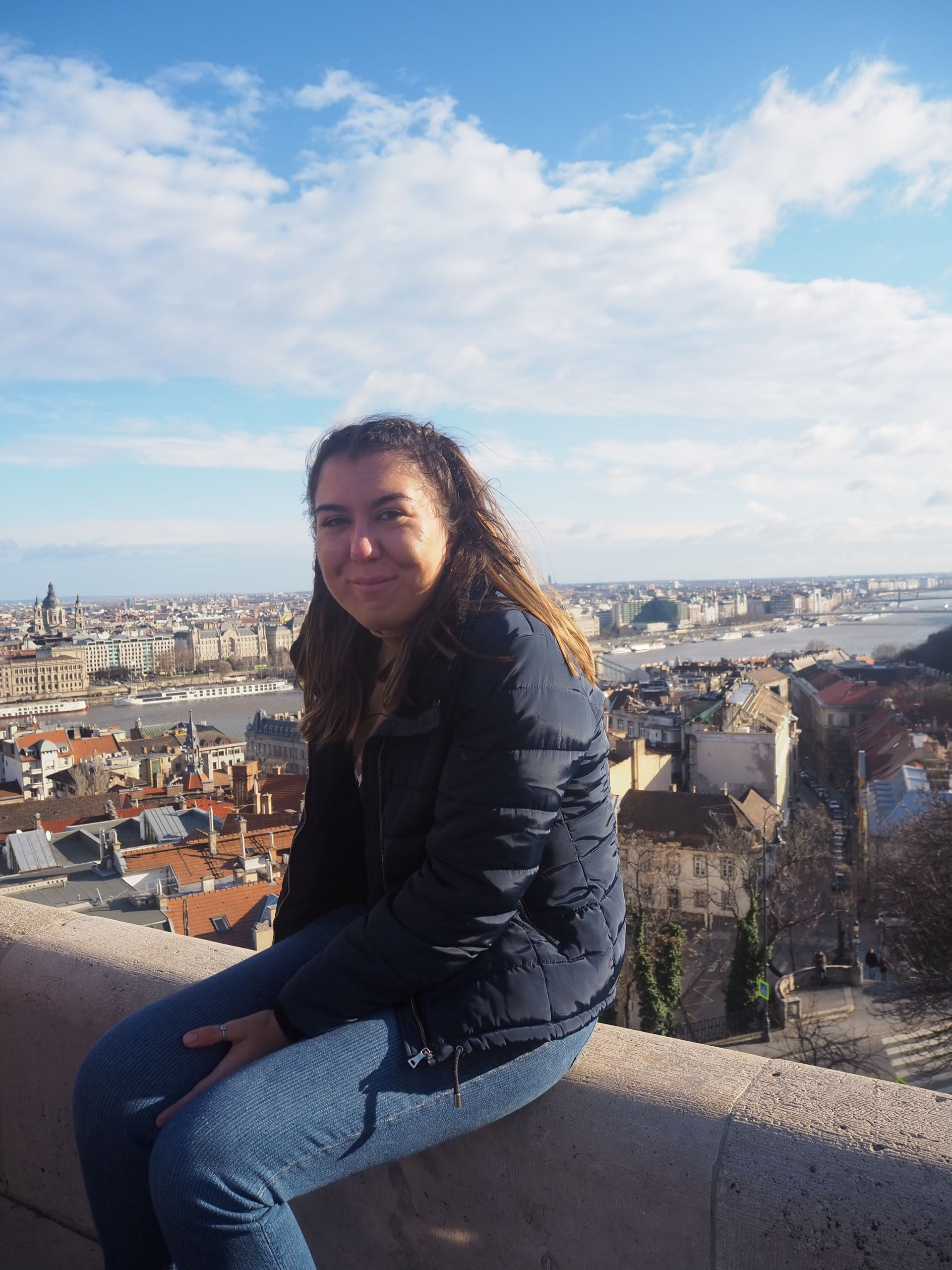 me sat at the top of the fisherman's bastion, with the Budapest cityscape behind me