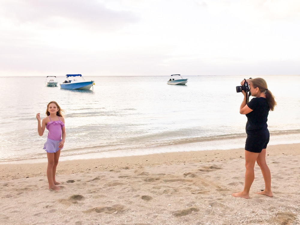 behind the scenes of a photo session on the beach